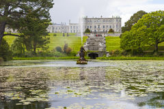 Enniskerry, Ireland - May 5: Triton Lake at Powerscourt. Enniskerry, Ireland - May 5: Fountain of the Triton Lake in the Italian Garden at Powerscourt State royalty free stock photography