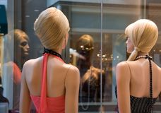 Ennui at the mall. A pair of blond mannequins royalty free stock photo