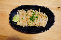 Enoki with lemon. Japan food style. Royalty Free Stock Image