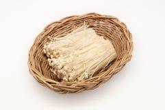 Enoki mushroom in basket weave Royalty Free Stock Images