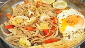 Enoki mushrooms fried with has fried eggs menu idea food full fr Stock Image
