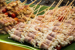 Enoki mushrooms wrapped with pork bacon, prepared for barbeque Stock Photos