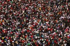 Enorm folkmassa Arkivbild