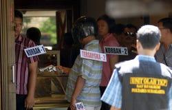 ENORMA OLÖSTA KALLA FALL FÖR DEN INDONESISKA POLISEN Royaltyfri Foto