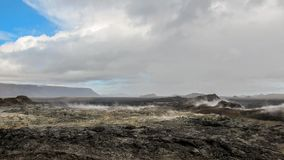 Enormes ruhiges dämpfendes Lavafeld an vulkanischem Bereich Krafla, Myvatn Seebereich, Nord-Island, Europa stockbilder