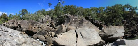 Australian landscape panorama. Enormous boulders make up this unique Australian landscape, seeming to form the shape of a giant turtle Royalty Free Stock Images