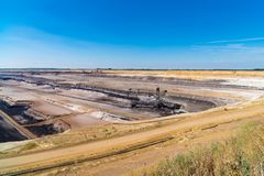 Lignite brown-coal mine in Germany. Enormous bucket-wheel excavator in an open pit lignite brown-coal mine at Garzweiler, Germany stock photos