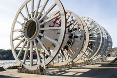 Enormous Cable rollers. These cable rollers are used by Nexans in Halden Norway. Nexans is a company that makes electrical cables, usually the kind that lays in Stock Image