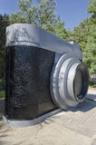 Enormous camera in a park Stock Photography