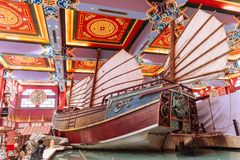 Enormous Chinese junk displayed in department store with colorful Chinese ceiling decorated with tourists in Dubai.  Royalty Free Stock Photos