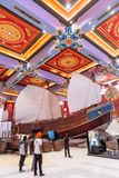 Enormous Chinese junk displayed in department store with colorful Chinese ceiling decorated with tourists in Dubai.  Stock Image