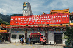 Enormous Guanyin statue over chinese style building at Kek Lok Si Temple at George Town. Panang, Malaysia Royalty Free Stock Photo