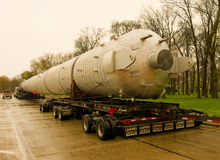 An enormous load being shipped by road on trailers Royalty Free Stock Photography
