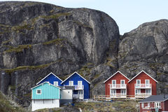Enormous rocks, colorful houses Stock Photos