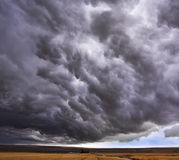 Enormous storm cloud above an  field Stock Photo
