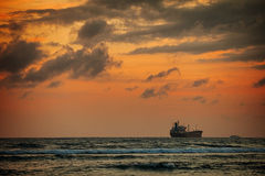Enormous Tanker Ship on the Horizon at Sunset Stock Photography