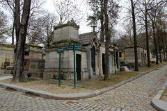 Enormous tombstones and pretty cobblestone walkways,Pere LaChaise Cemetery,Paris,France,2016 Royalty Free Stock Photos