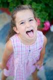 Enough!. Cute little girl showing off her tounge and just being a child Royalty Free Stock Photo