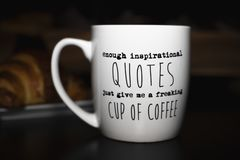 Enough inspirational quotes just give me a freaking cup of coffee`. `Enough inspirational quotes just give me a freaking cup of coffee` coffee mug for humorous stock photos