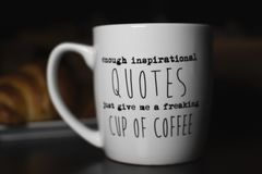 Enough inspirational quotes just give me a freaking cup of coffee`. `Enough inspirational quotes just give me a freaking cup of coffee` coffee mug for humorous stock photo