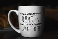 Enough inspirational quotes just give me a freaking cup of coffee`. `Enough inspirational quotes just give me a freaking cup of coffee` coffee mug for humorous stock images