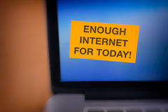 Enough Internet For Today!. Yellow paper note on laptop screen with writing  Blur effect stock image