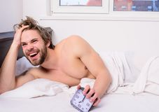 Enough sleep for him. Regulate your bodys clock. Man unshaven tousled hair wakeful face having rest. Good morning. Man royalty free stock photo