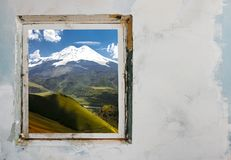 Enough To Stay At Home, Go For A Walk. Summer Concept Travel And. Adventure. Window with a picturesque view of the Elbrus Mount with copy space stock photo