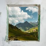 Enough To Stay At Home, Go For A Walk. Summer Concept Travel And. Adventure. Window with a picturesque view of the mountains stock image