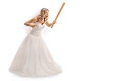 Enraged bride holding a baseball bat Royalty Free Stock Photography