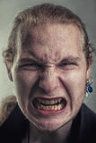 Enraged crazy man. Grunge portrait of a furious mad man, young caucasian male, mid 20s Royalty Free Stock Photo