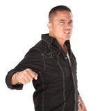 Enraged Latino Man. Enraged Hispanic man with fist on white background stock photos
