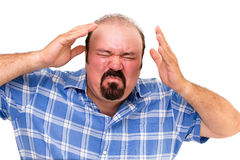 Enraged man wringing his hands. Enraged man with a flushed red face wringing his hands in frustration and anger as he grimaces in frustration, isolated on white royalty free stock photos