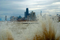 Enraged Michigan lake, Chicago, Illinois. Chicago Downtown through the waves of  stormy Michigan lake, Illinois Stock Image