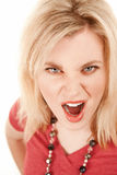 Enraged young woman. Young blonde woman with enraged expression on her face Royalty Free Stock Photo