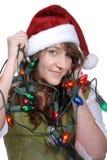 Enredado para arriba en luces de la Navidad Imágenes de archivo libres de regalías