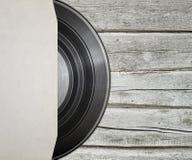 Enregistrement de vinyle avec le cache photographie stock libre de droits