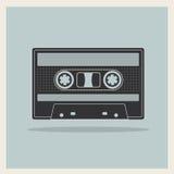 Enregistreur à cassettes compact audio sur le rétro fond Image stock