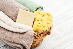 Enriched with Shea Butter, 100% vegetal soap. With bath towels and bath sponge in bowl closeup stock images