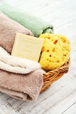 Enriched with Shea Butter, 100% vegetal soap. With bath towels and bath sponge in bowl closeup Royalty Free Stock Photo