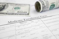 Enroll in Medicare. Medicare enrollment form and money royalty free stock photo