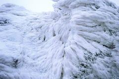 Enrolle el modelo pintado de la textura de la nieve en el fondo de piedra, invierno imagen de archivo libre de regalías