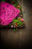 Enrruelle en una forma del corazón hecha de hierba Imagen de archivo libre de regalías