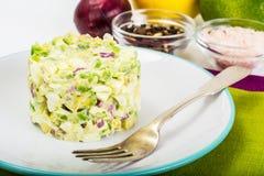 Ensalada con el aguacate, los huevos hervidos, la cebolla roja y la mayonesa Imagen de archivo libre de regalías