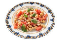 Ensalada con el tomate y la albahaca Imagen de archivo libre de regalías