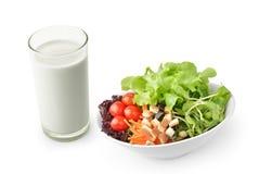 Ensalada con leche en el fondo blanco Foto de archivo libre de regalías
