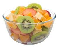 Ensalada de fruta en el tazón de fuente de cristal Foto de archivo libre de regalías