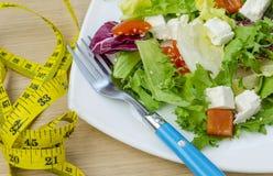 Ensalada dietética con los tomates y el queso feta Imagenes de archivo