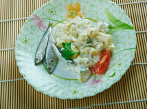 Ensaladilla Rusa. Potato Salad Recipe - Ensaladilla Rusa with anchovies . closeup of a plate Royalty Free Stock Photos