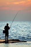 ensam fiskare Fotografering för Bildbyråer